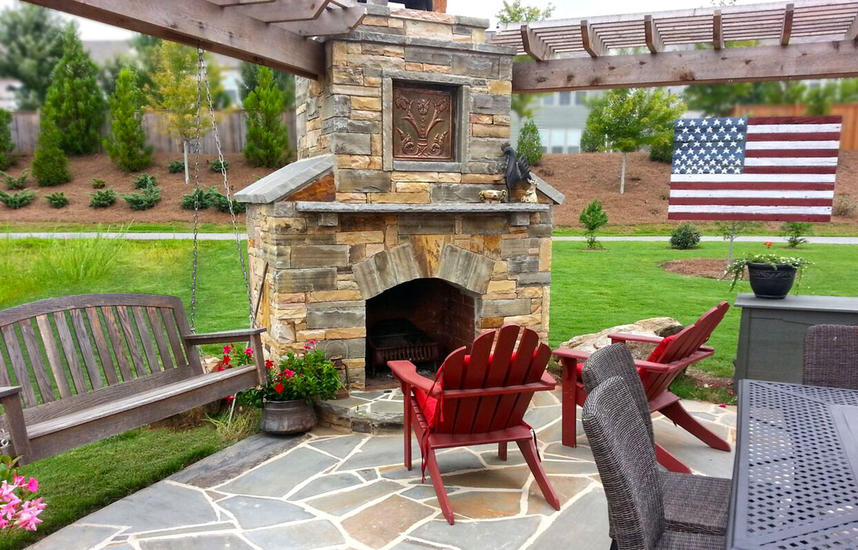 Stone Fireplace And Patio Added Outdoor Living Space To A Wooded Backyard  In Marietta, Georgia. Our Customer Added Container Flowers For Color.